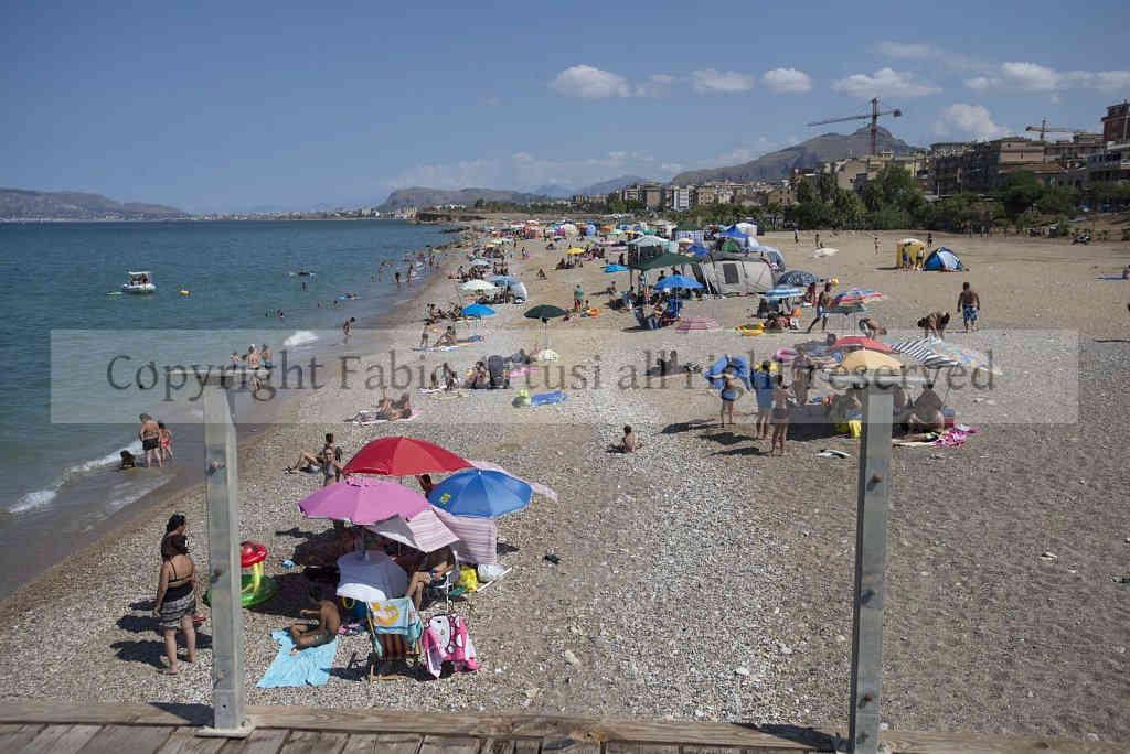 """Ferragosto to """"Romagnolo beach"""", Palermo. Sicily"""
